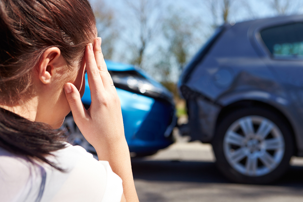 woman in whiplash accident needing chiropractic treatment